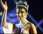 A jubiliant Priyanka waves out to a hysterical crowd as Miss World