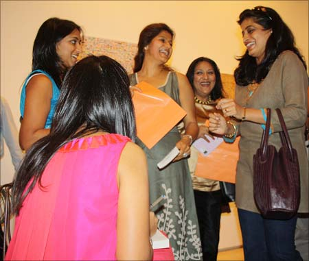 Amrita chats with a group of women at her book launch