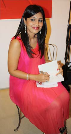 Amrita signs a copy of <I>Faking It</I>