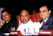 Dhirubhai Ambani with his sons Anil, left, and Mukesh (right)