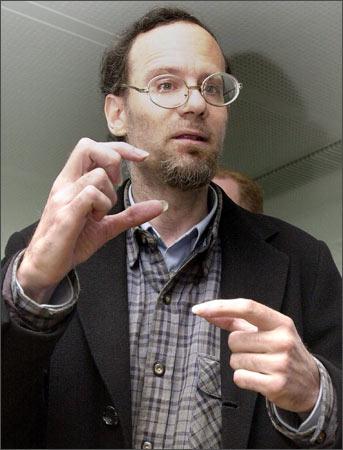 Martin Frankel gestures prior to his trial