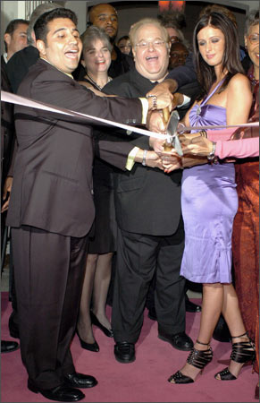 Lou Pearlman (centre) and hotel heiress Nicky Hilton (right) cut the ribbon at the grand opening of Club Paris in Orlando, Florida on December 30, 2004.