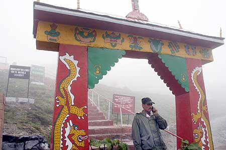 A soldier stands at the gate near Nathu La