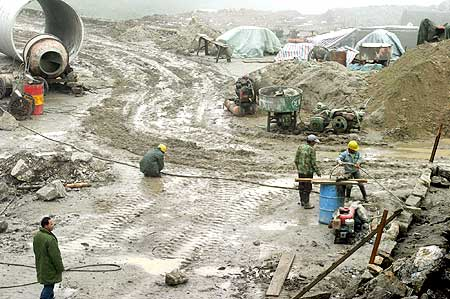 Chinese workers prepare a road along the India-China route at Nathu La