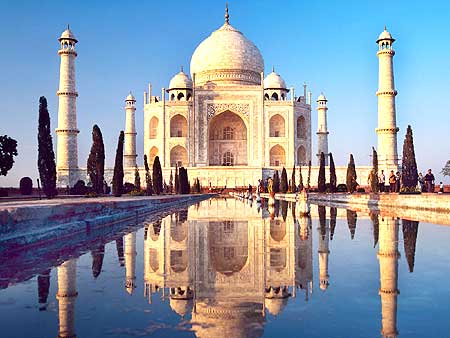 The Taj Mahal sits behind its famous reflecting pool