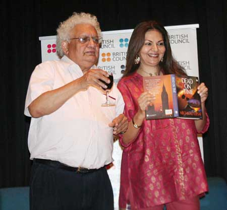 Lord Desai poses with a glass a wine and a copy of Dead on Time