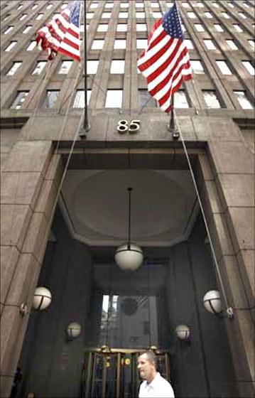 A man walks past the Goldman Sachs headquarters building in New York.