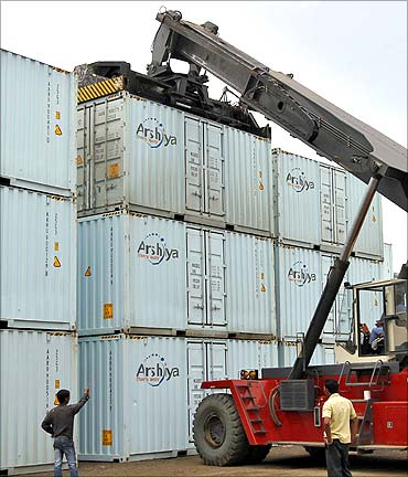 A container is lifted to load onto a truck at Thar Dry Port in Sanand.