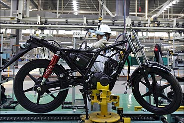 An employee works at an assembly line of Twister motorcycle.