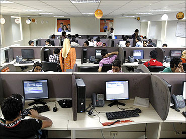 Employees work at a call centre near Srinagar.