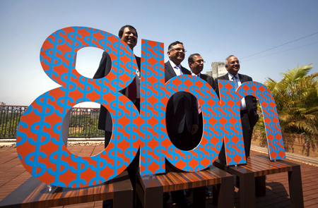 N. Chandrasekaran (2nd L), Chief Executive of Tata Consultancy Services (TCS), poses for a photo with members of his management team before a news conference to announce the company's Q4 results in Mumbai April 21, 2011.