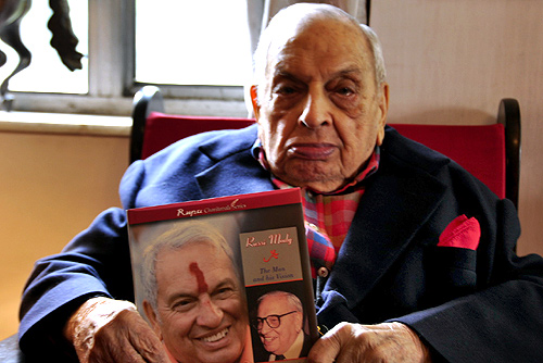 Russi Mody poses with a book on him.