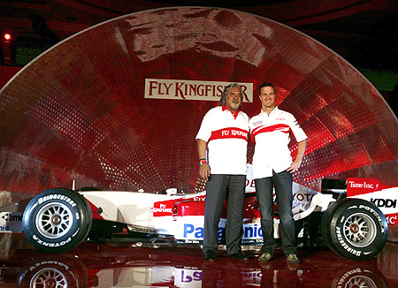 Vijay Mallya , Chairman and Chief Executive Officer of Kingfisher Airlines Ltd and Toyota's Formula One driver Ralf Schumacher of Germany pose for photographers.