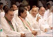 Congress Chief Minister Sushilkumar Shinde making a point to his predecessor Vilasrao Deshmukh as actor-turned-MP Sunil Dutt looks on. Photo: Jewella C Miranda