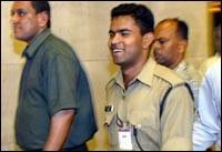 Raj Namdeo being taken away by police officers after he surrrendered. Photo: Deepak Salvi