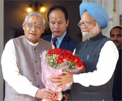 Prime Minister Manmohan Singh greets former prime minister Atal Bihari Vajpayee on his birthday in December 2006.
