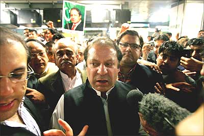 Nawaz Sharif speaks to the media inside Heathrow airport in London, before he boarded a flight to Islamabad.