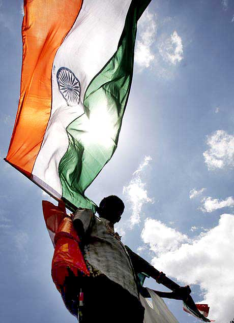 A man waves the Indian flag