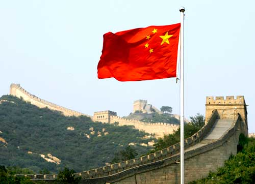A Chinese flag flutters against the backdrop of  the Great Wall of China