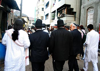 Jewish leaders from Israel and New York walk down a Colaba bylane, on the way to Nariman House.