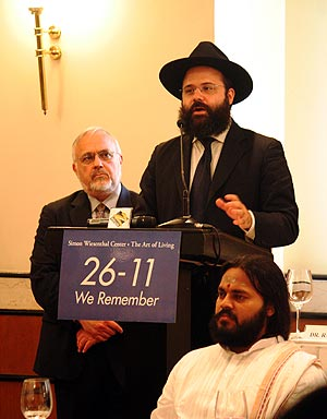 Rabbi Berkowitz speaks at the Inter-Faith conference at the Trident Hotel, with Rabbi Abraham Cooper (behind) and Swami Gnanatej looking on