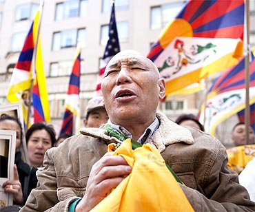 A follower of the Dalai Lama cries after they were greeted by him outside of his hotel