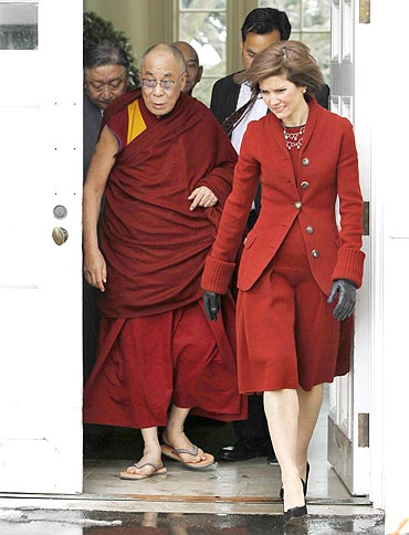 The Dalai Lama escorted in White House by Chief of Protocol Capricia Marshall