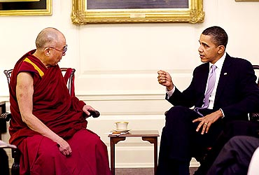 The Dalai Lama speaks to US President Obama at Map Room in White House on Thursday