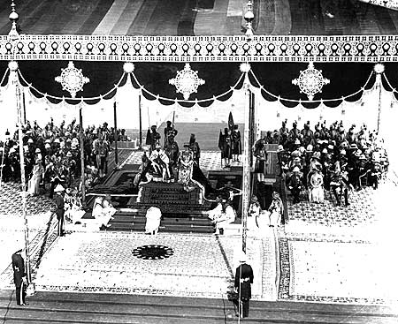 Members of the Indian nobility pay homage to King George V and his queen at the Coronation Durbar in Delhi on December 11 1911