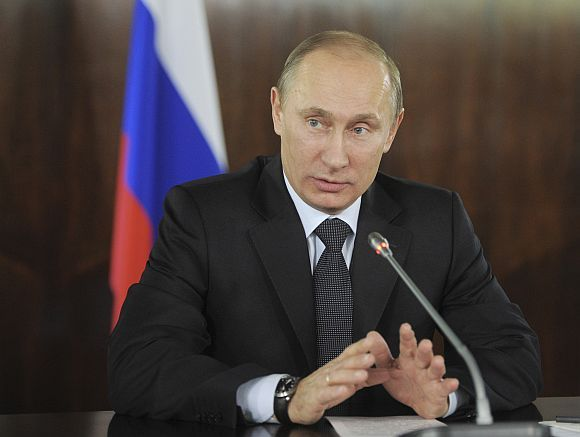 Russian PM Putin gestures during a meeting with organisers of the All-Russian People's Front in Moscow