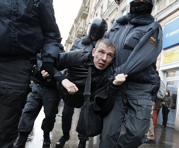 Security forces detain an anti-government protestor in Moscow on Saturday