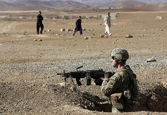 A US army soldier takes position during a cooler storage utilisation assessment mission in Logar province of Afghanistan