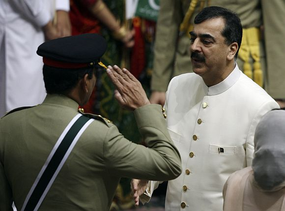 File image of Pakistani PM Gilani with army chief Kayani during a function in Islamabad