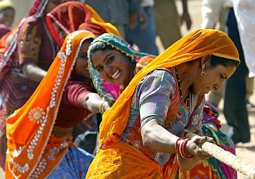 Rajasthani women take part in tug of war game at Pushkar fair