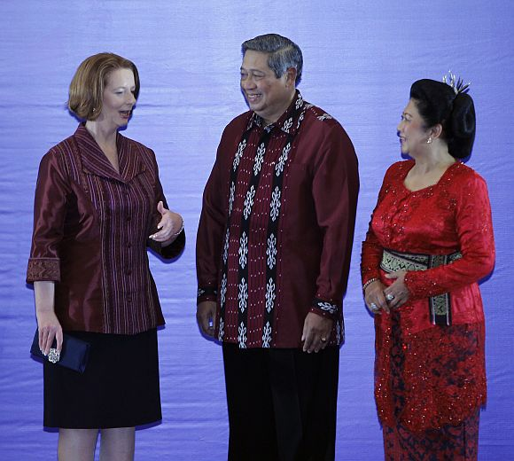 Australian Prime Minister Julia Gillard is greeted by Indonesian president