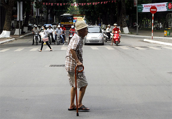 A voter walks on a street to a polling station in Hanoi, Vietnam