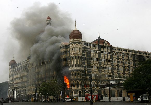 Hotel Taj Mahal is engulfed in smoke during the 26/11 terror attacks in Mumbai