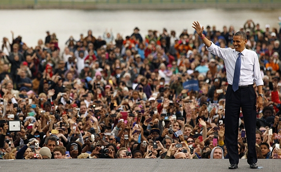 United States President Barack Obama waves to supporters during a campaign rally in Denver, Colorado