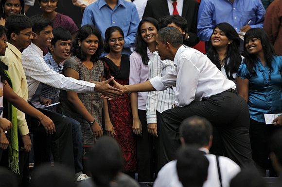 Obama greets students at a town hall meeting at St Xavier's college in Mumbai in this November 7, 2010 photograph