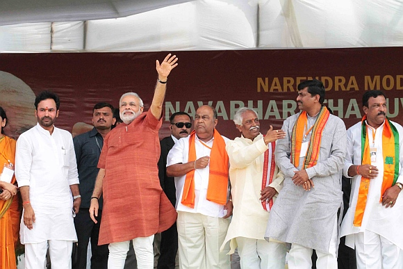 Modi waves at the gathered crowd at the Lal Bahadur stadium