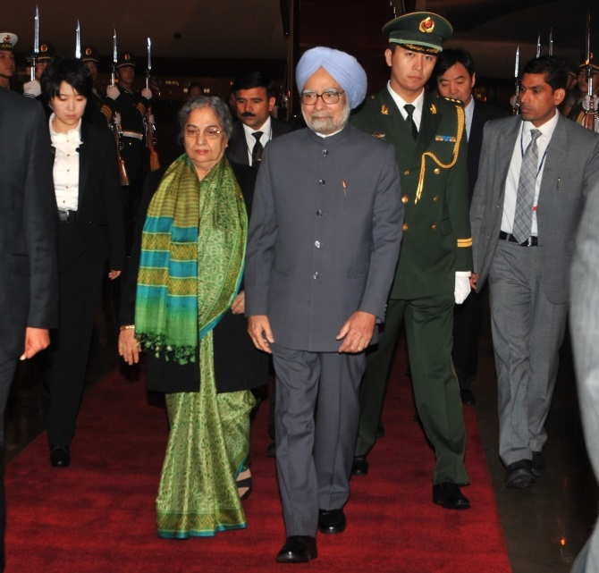 Dr Singh and his wife Gursharan Kaur arrive at the Beijing International Airport in China on Tuesday.