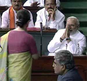 Congress President Sonia Gandhi greets Prime Minister Narendra Modi