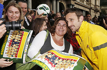 Australia's player Josh Kennedy poses for pictures with fans during an event to celebrate their World Cup qualification in central Sydney on Wednesday
