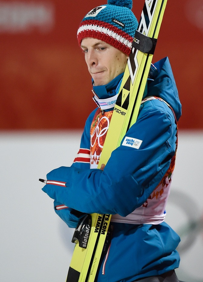 Michael Hayboeck of Austria looks during the Men's Large Hill Individual.