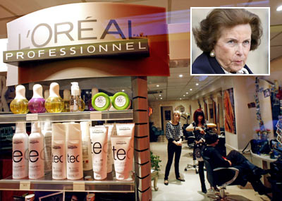 L'Oreal cosmetic and beauty products are seen in a hairdresser shop in Nice, southern France (Inset: Liliane Bettencourt)