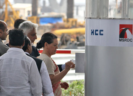 Sonia Gandhi uses her pass at the automated toll system