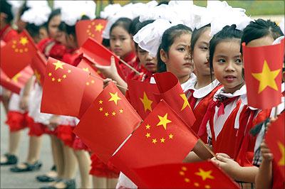 Children wave Vietnamese and Chinese flags to welcome Vice-President  Xi Jinping, who will be China's next president , in Hanoi