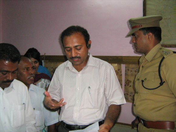 Tirunelveli District Collector Selvaraj and SP Bidari stepping out of the peace meet.
