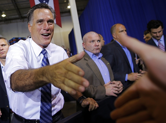 US Republican presidential nominee Mitt Romney greets audience members at a campaign stop at Jet Machine in Cincinnati