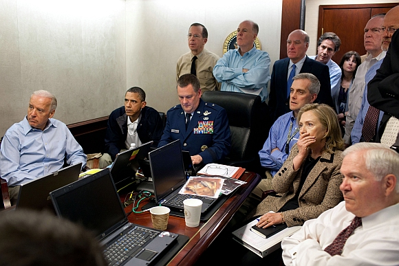 US President Barack Obama and Vice President Joe Biden (left), along with members of the national security team, receive an update on the mission against Osama bin Laden in the Situation Room of the White House in this May 1, 2011 photograph